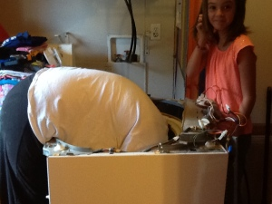 Special family time indeed...Caitlin, my oldest playing washer repairman